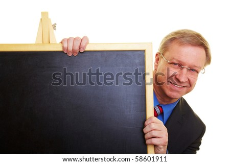 Senior businessman in a suit behind a chalkboard