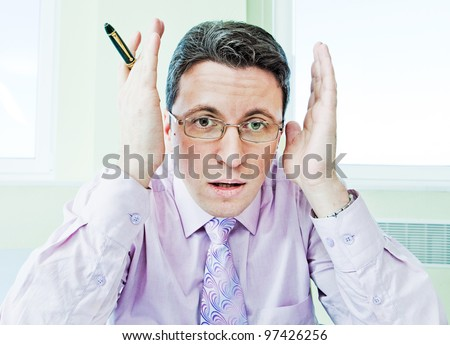 Senior businessman in stress working in office room - stock photo