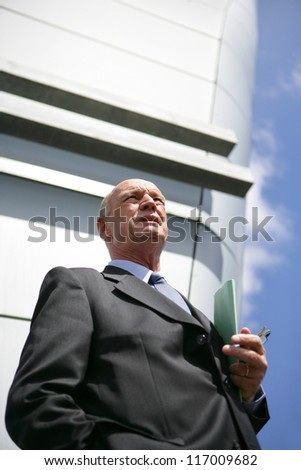 Senior businessman in the city - stock photo
