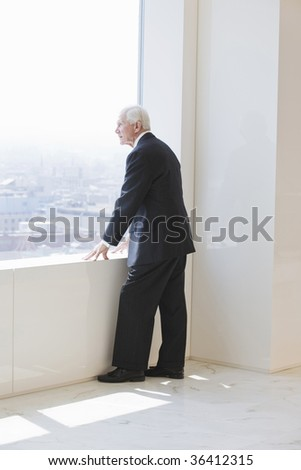 Senior businessman looking out - stock photo