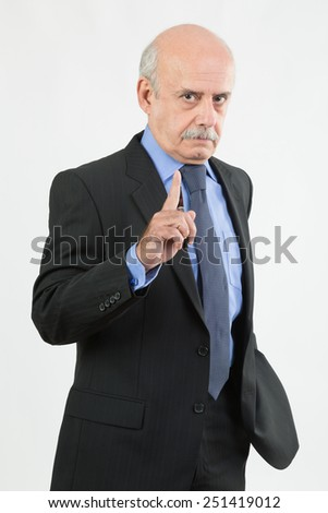 senior businessman pointing at you
