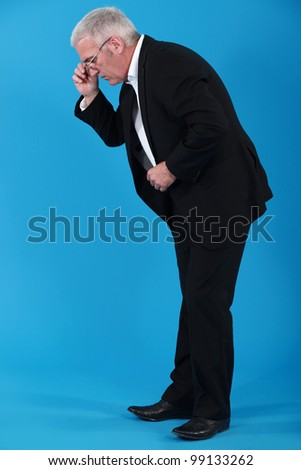 Senior businessman ready to retire - stock photo