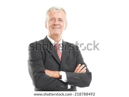 Senior businessman standing against white background.  - stock photo