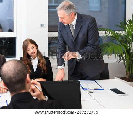 Senior businessman talking during a meeting in an office - stock photo