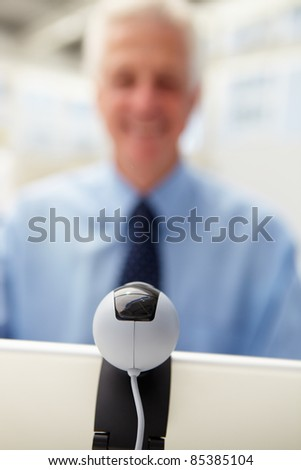 Senior businessman using skype