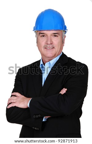 senior businessman wearing a helmet - stock photo