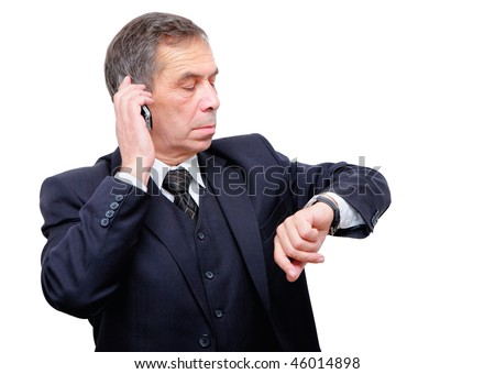 senior businessman witch watch checking time - stock photo