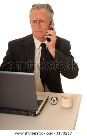 Senior businessman with a rather interesting expression on a cell telephone