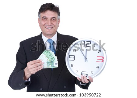 senior businessman with money and wall clock, concept time is money - stock photo