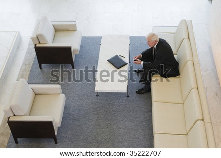 Senior businessman with notepad