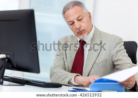 Senior businessman working at his desk in the office