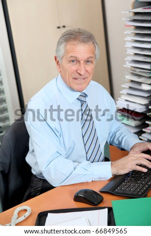Senior businessman working in the office