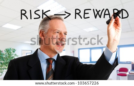 Senior businessman writing a business concept on the screen - stock photo