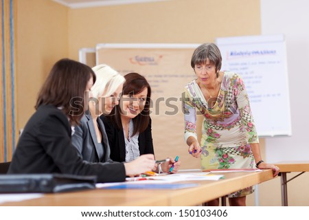 senior businesswoman in a meeting with colleagues - stock photo