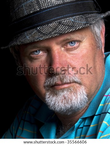 Senior caucasian man with hat on - stock photo