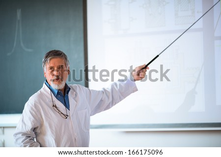 Senior chemistry professor giving a lecture in front of classroom full of students (shallow DOF; color toned image)