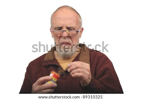 Senior Citizen Disgusted by his Medication - stock photo