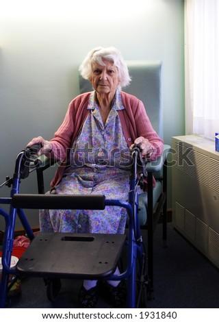 Senior citizen holding walking frame - stock photo