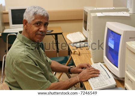 Senior citizen learning computer skills - stock photo