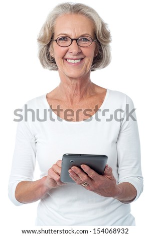 Senior citizen posing with tablet pc over white - stock photo