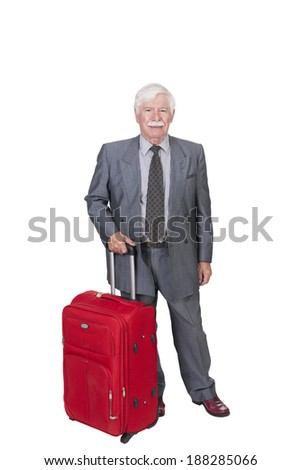 senior citizen with red suitcase standing on a white background in studio - stock photo