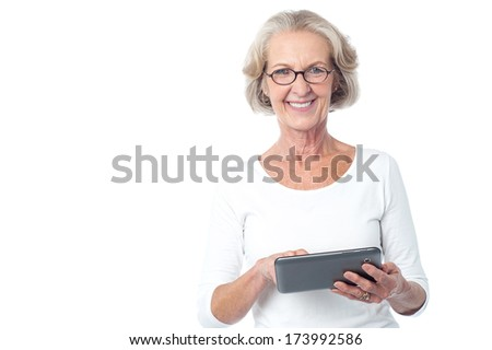 Senior citizen working on new tablet pc - stock photo