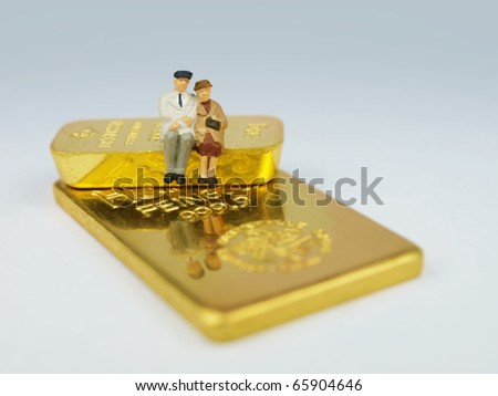 Senior citizens with their treasure of gold - stock photo