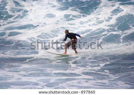 Senior class contestant faces big waves at local surf contest at Ho'okipa beach on Maui, Hawaii - stock photo