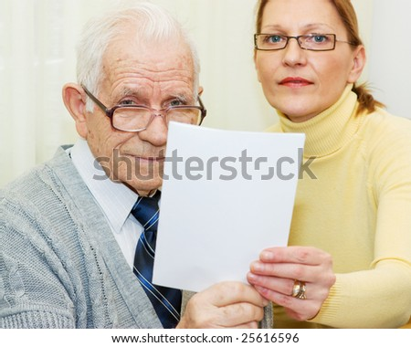 Senior client and woman agent togetherness holding an agreement - stock photo