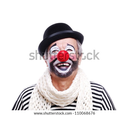 Senior clown in bowler hat looking to the copy space area - stock photo