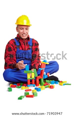 Senior construction worker playing with wood blocks