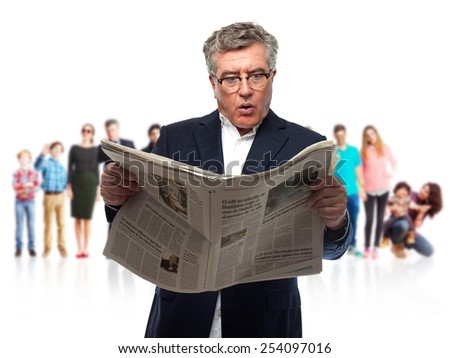 senior cool man surprised with a newspaper - stock photo