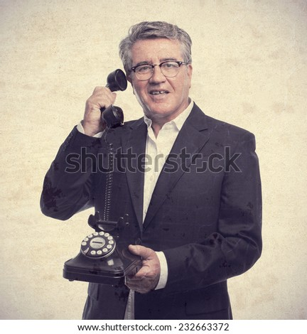 senior cool man with a phone - stock photo