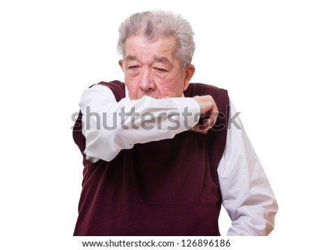 Senior coughs and holds the arm in front of the mouth - stock photo