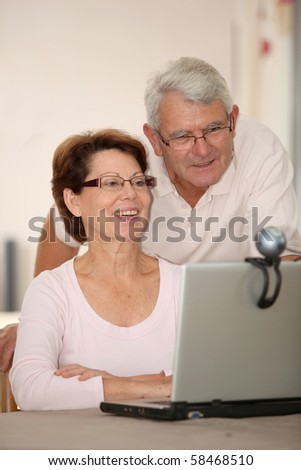 Senior couple and videocall - stock photo
