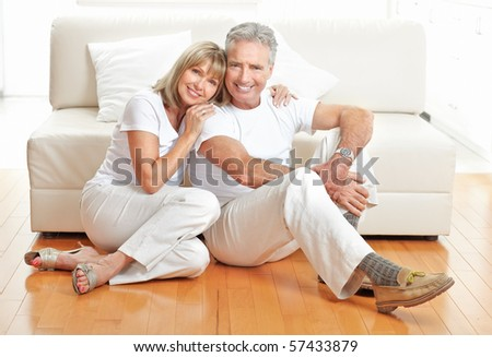 Senior couple at home smiling and happy - stock photo