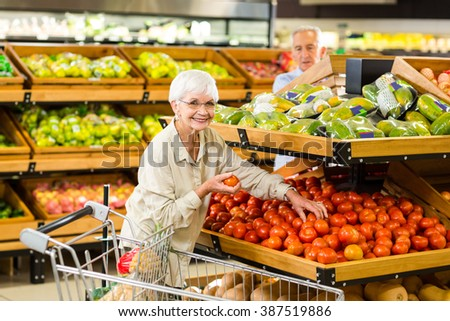 Senior couple buying food at the grocery shop