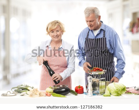 Senior couple cooking in the kitchen.