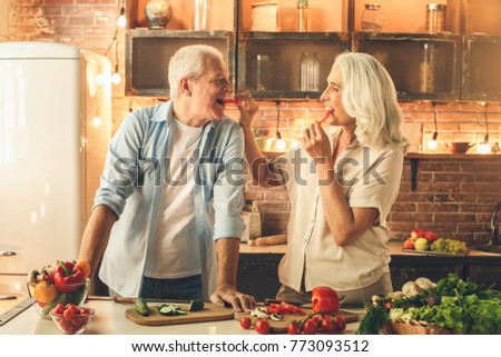 Senior couple cooking together at home love