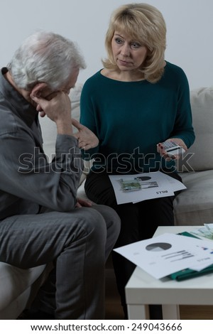 Senior couple discussing about financial problems - stock photo