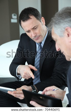 Senior couple discussing financial plan with consultant - stock photo