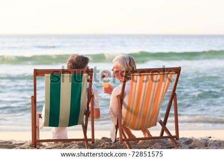 Senior couple drinking a cocktail - stock photo