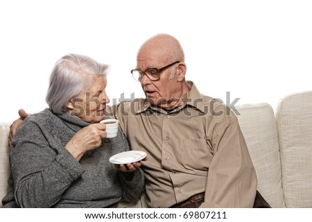 Senior couple drinking coffee - stock photo