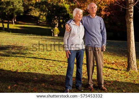Senior couple embracing in a park