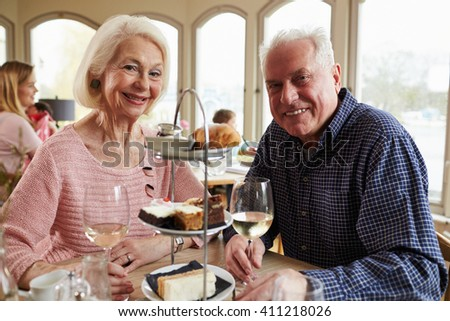 Senior Couple Enjoying Afternoon Tea In Restaurant Together