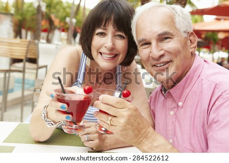 Senior Couple Enjoying Cocktails In Outdoor Bar Together - stock photo