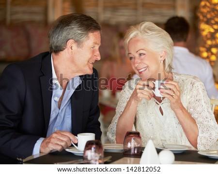 Senior Couple Enjoying Cup Of Coffee In Restaurant - stock photo