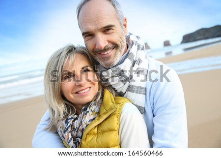 Senior couple enjoying peaceful time at the beach