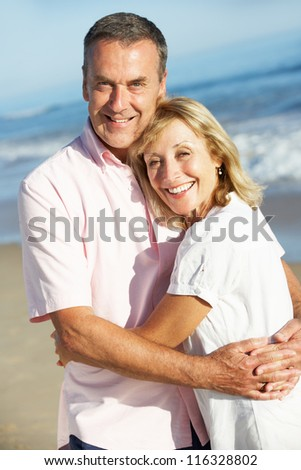 Senior Couple Enjoying Romantic Beach Holiday - stock photo