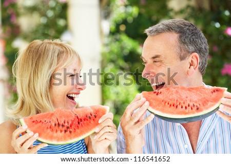 Senior Couple Enjoying Slices Of Water Melon - stock photo